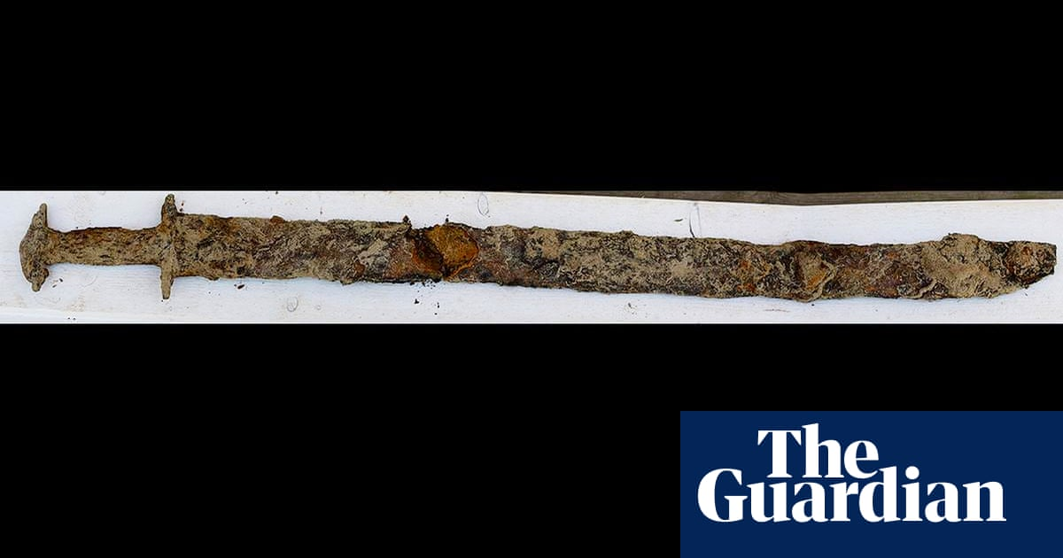 Sweden's 'true queen', 8, pulls ancient sword from lake