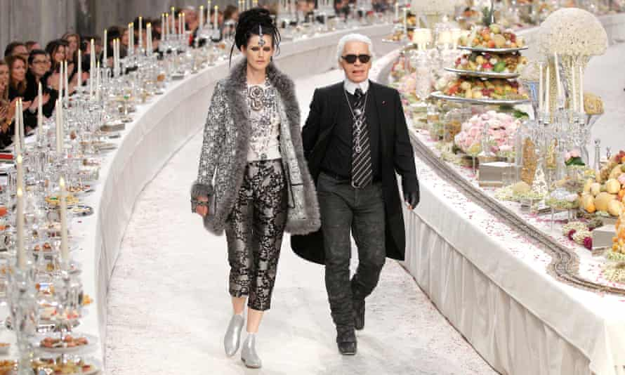 Stella Tennant walks with designer Karl Lagerfeld during the Metiers D'Art show for Chanel in Paris, 2011.