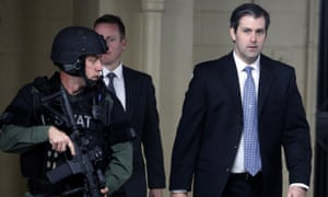 Michael Slager walks from the Charleston County courthouse under protection on 5 December 2016 in South Carolina.