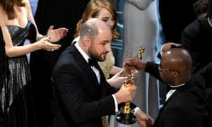 Horowitz hands the Oscar to Moonlight writer/director Barry Jenkins.