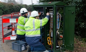 BT Openreach engineers working on a broadband internet fibre cabinet in the street.