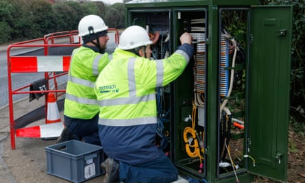 BT Openreach engineers working on a broadband fibre cabinet in the street