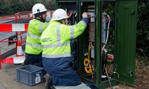BT Openreach engineers working on a broadband internet fibre cabinet