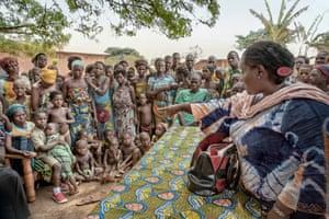 Carmen Azainon, a social affairs supervisor in Zogbodomey, Benin, talks to villagers