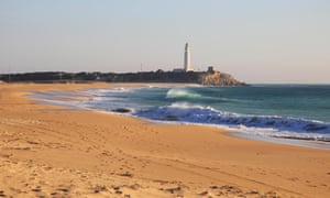 Sandy beach and lighthouse at Cabo de Trafalga