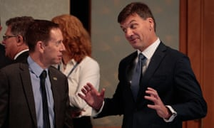 Shane Rattenbury (left) in discussion with the federal minister for energy and emissions reduction, Angus Taylor