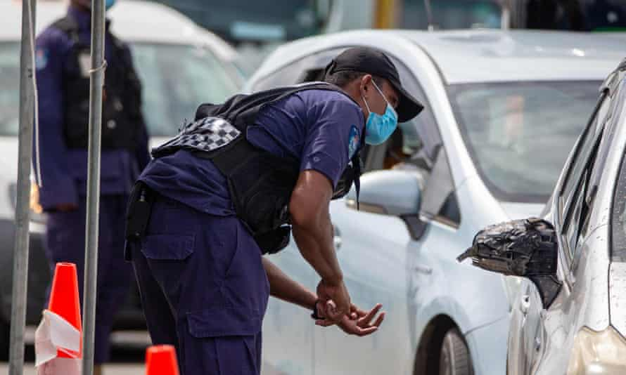 Security officers staff a checkpoint at a junction in Fiji's capital, Suva.