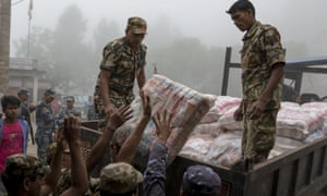 Nepal military personnel load relief supplies onto a truck at the Gorkha district office.