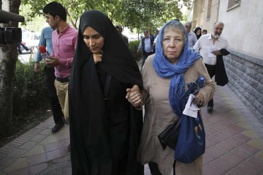 Mary Rezaian, mother of detained Washington Post correspondent Jason Rezaian, right, and Jason's wife Yeganeh leave a Revolutionary Court building in Tehran.