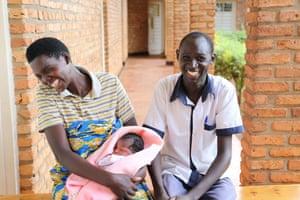 Samuel Nshimyumukita, 30, nurse-midwife, with Ruth Nyirahabimana, 24, and her baby, Uwamahoro Emeline, at Nzangwa Health Centre, Kintambwe, Rweru, Bugesera, Rwanda