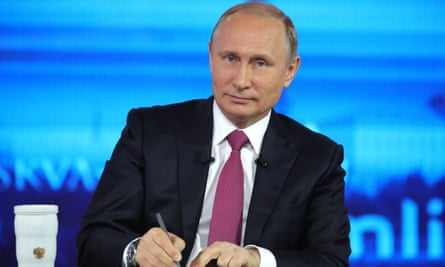 Russian president Vladimir Putin makes notes as he listens to a question during his annual televised call-in show in Moscow on Thursday.