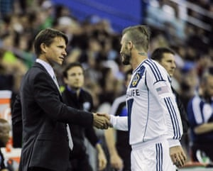 David Beckham of LA Galaxy shakes hands with the then Montreal Impact coach Marsch before their match on 12 May, 2012.