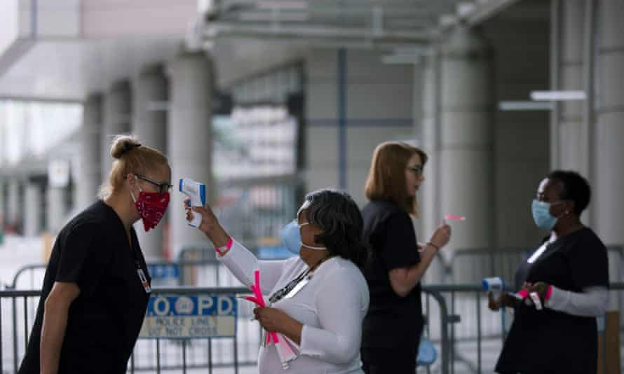 Medical personnel take temperature as they prepare the Ernest N Morial convention center for Covid-19 patients in New Orleans, Louisiana, on Monday.