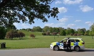 Police officers patrol Primrose Hill in London.
