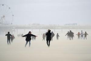 Beachgoers in Scheveningen district in the Netherlands