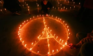 Nepalese people form the shape of the Eiffel Tower with candles during a candlelight vigil, in Kathmandu, Nepal.