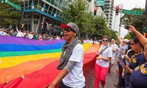 Atlanta Pride Parade passes down Peachtree Street.