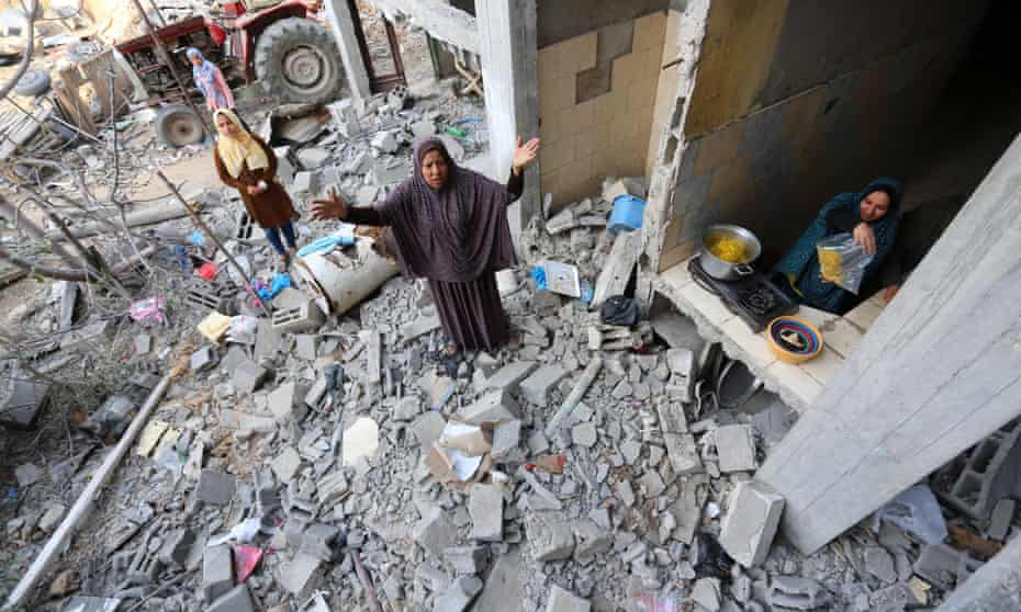 Palestinians return to their houses which were destroyed by the Israeli military, in Beit Hanoun, in the northern Gaza Strip, on Friday.
