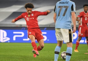 Bayern Munich's Leroy Sane scores their third goal.