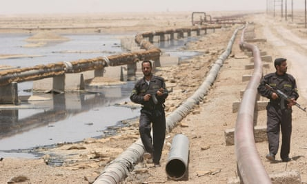 Iraqi police officers protecting an oil pipeline north of Basra in 2008. DynCorp faces allegation for the period of 2004-2008 when it held the police training contract.