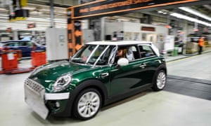 A Mini comes off the assembly line at its factory in Cowley, near Oxford.
