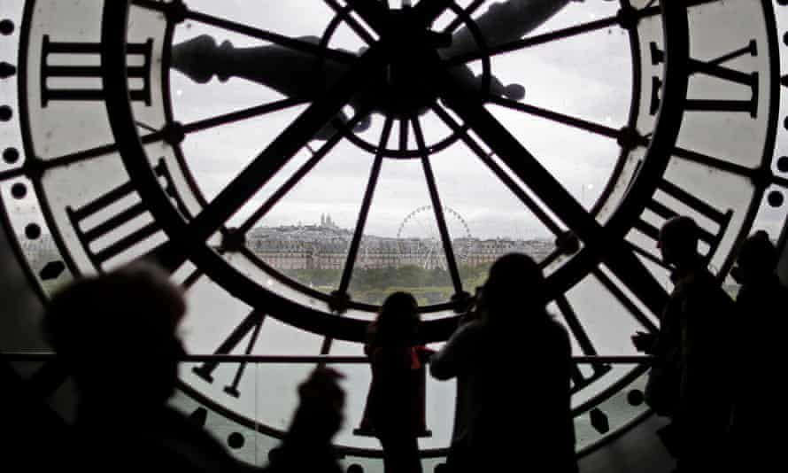 Visitors look through the giant clock at the Musée d'Orsay