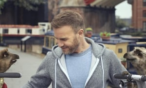 Pop star Gary Barlow with Aleksandr and Sergei the meerkats in one of comparethemarket.com's adverts