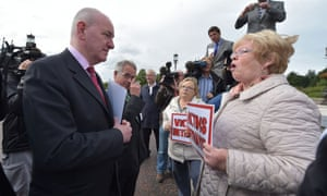 Mark Durkin of the SDLP is confronted by Kate Nash, a family member of one of the Bloody Sunday victims at Stormont yesterday.
