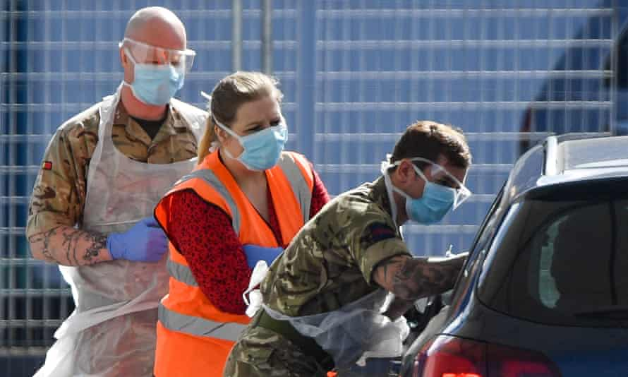 Military personnel help administer Covid-19 tests for NHS workers at Edgbaston cricket ground, Birmingham