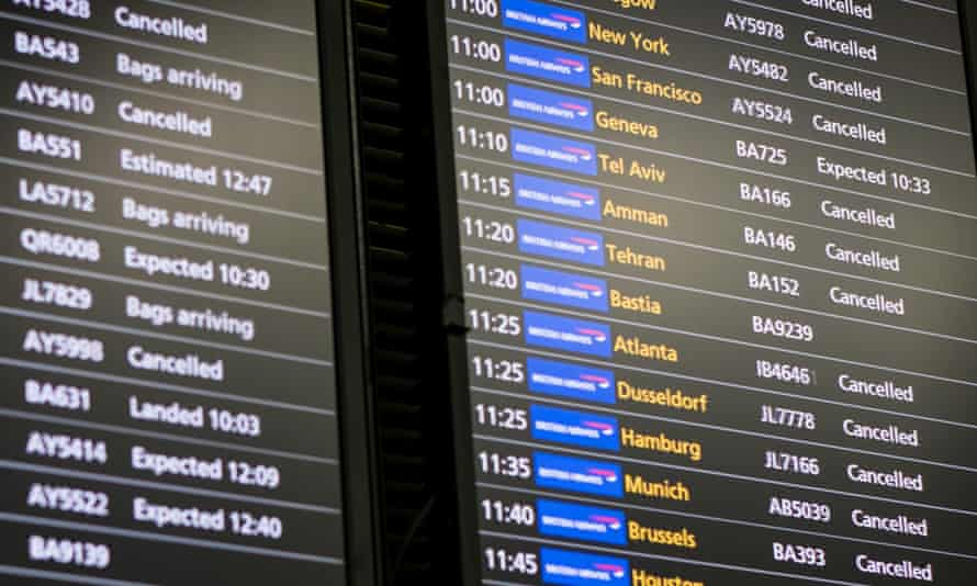 A flight information board displays a number of cancelled British Airways flights at Heathrow Airport Terminal 5 on May 28, 2017