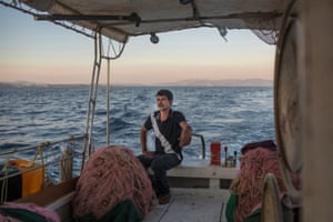 Mohammed El-Hamisi, an Egyptian fisherman on his boat, with which he saved 48 people from the fires in Greece in July 2018