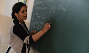 Teacher writing on board in India