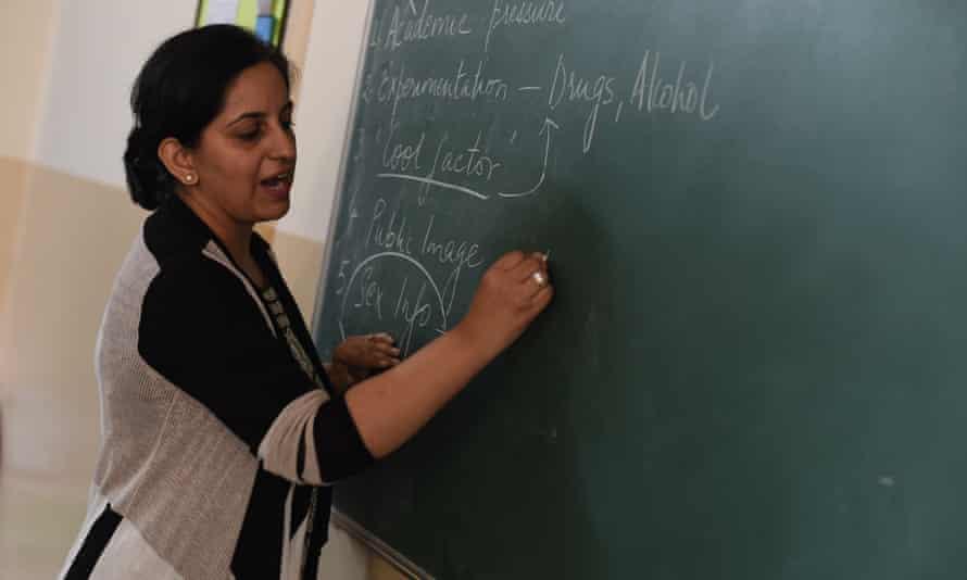 Teacher writing on board in India