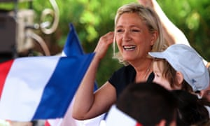 Front National leader Marine Le Pen smiles during a political rally in Brachay, northeastern France.