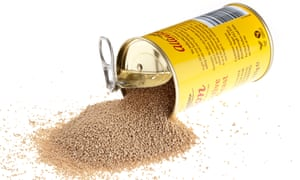 Tin of dried active yeast spilling