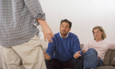 Parents discussing with son rear view