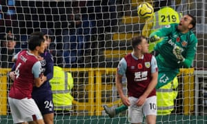 Roberto, the West Ham goalkeeper, punches the ball into the net to concede an own goal against Burnley.