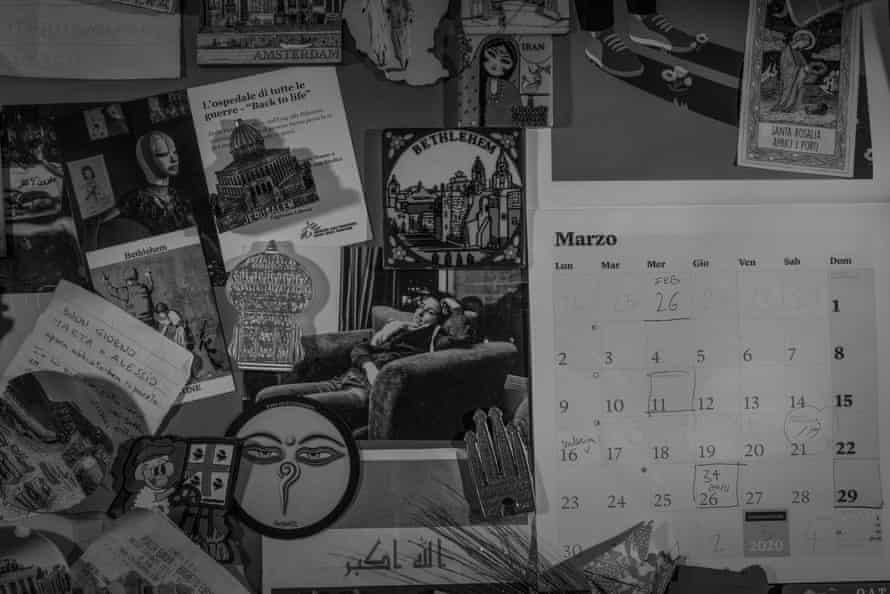 Calendar, magnets and various objects hanging on the fridge at home.