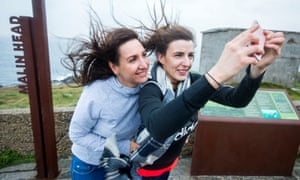 Autumn weather Oct 16th 2017Two Donegal locals take a selfie at Banba's Crown, Malin Head. Co.Donegal, Ireland, as Hurricane Ophelia hits the UK and Ireland with gusts of up to 80mph. PRESS ASSOCIATION Photo. Picture date: Monday October 16, 2017. Three people have been confirmed dead in Ireland in incidents related to Storm Ophelia. See PA story WEATHER Ophelia Ireland. Photo credit should read: Liam McBurney/PA Wire