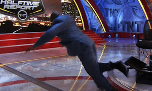 Shaquille O'Neal flies through the air on TNT's Halftime Report.