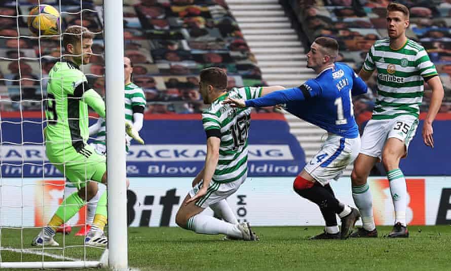 Celtic's Jonjoe Kenny scores an own goal under pressure from Ryan Kent of Rangers.