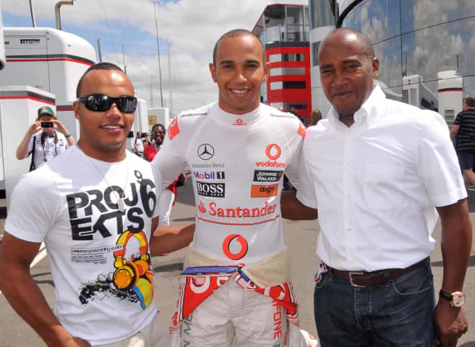 With his father, Anthony, and his half-brother, Nicholas, who is also a racing driver, at Silverstone in 2010.