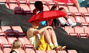 Mesut Özil watches Arsenal play Southampton in July
