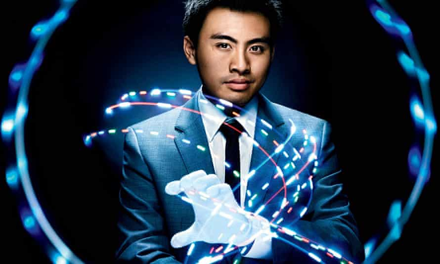 Brian Lim demonstrates light-up gloves.
