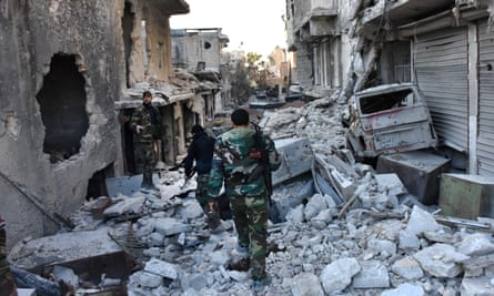 Syrian pro-government forces in Aleppo's Bustan al-Pasha neighbourhood