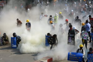 Protesters react to teargas fired by police in the north-western town of Kale