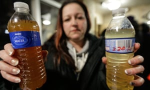 LeeAnne Walters shows water samples from her Flint home.