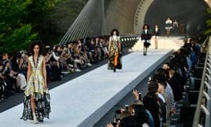 At the entrance to the Miho Museum, Japan, models display the latest creations designed by Nicolas Ghesquiere for the Louis Vuitton cruise collection 2018.