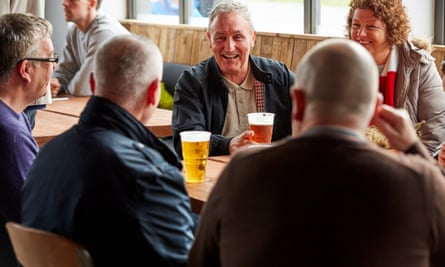 People in pub smiling and chatting