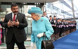 London, UK. The Queen with the chairman and CEO of BA, Álex Cruz, during her visit to the company's headquarters at Heathrow airport to mark BA's centenary year
